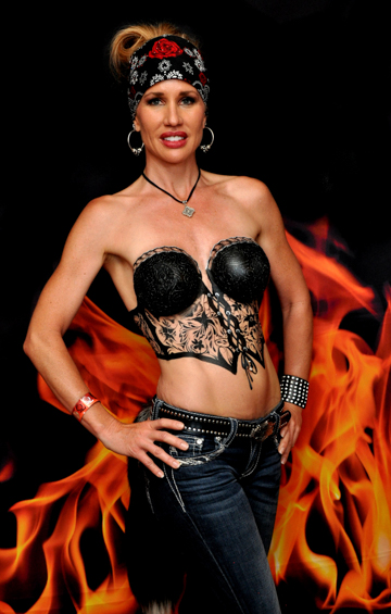 body painted blonde woman that has a very detailed black corset painted on her chest