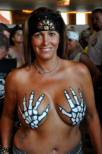 woman body painted with skelaton hands painted on breasts