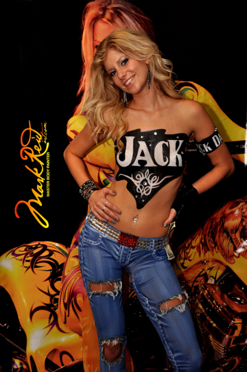 blonde woman with a stylized jack daniels logo on her chest
