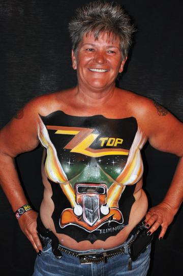 woman with a chest and torso body painting of the zz top eliminator album cover
