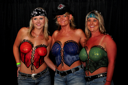three women in detailed body painted corsets