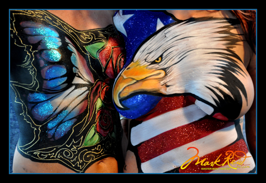 chest of one woman with an elaborate butterfly design and chest of another woman with an elaborate bald eagle head over an american flag