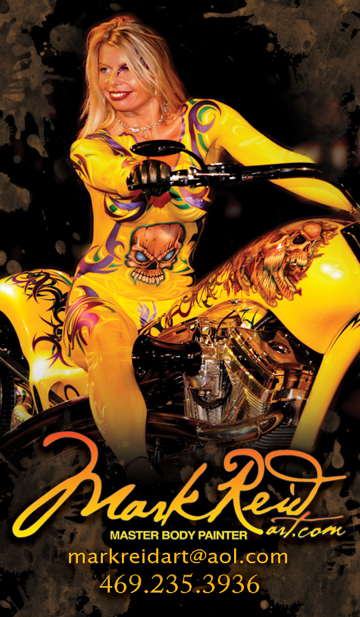 blonde woman with very intricate  bright yellow full body painting that matches the motorcycle she is seated on